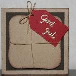Julkort med paket och röd etikett