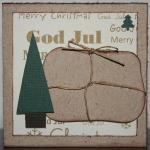 Julkort i guld med paket och smågranar