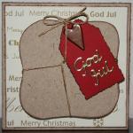 Julkort i guld med paket och röd etikett