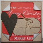 Julkort i rött med paket och hjärta
