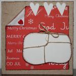 Julkort i rött med vitt paket och hjärtan