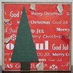 Julkort i rött med slitna kanter och gran