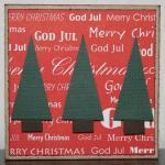 Julkort i rött med tre små granar