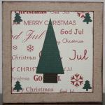 Julkort i vitt med en stor och fyra små granar