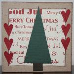 Julkort i vitt med röda hjärtan och gran