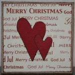 Julkort i vitt med röda hjärtan