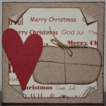 Julkort i vitt med paket och rött hjärta