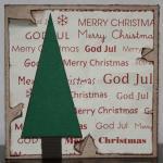 Julkort i vitt med rivna kanter och gran
